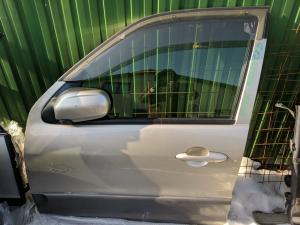 дверь Mazda Tribute