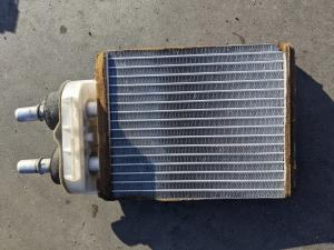 радиатор печки Mazda Familia